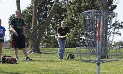 Students disc golfing