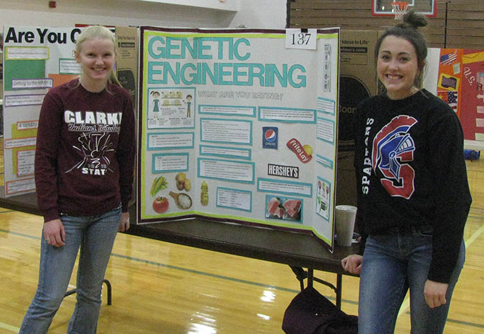Two students with their poster at Poster Day