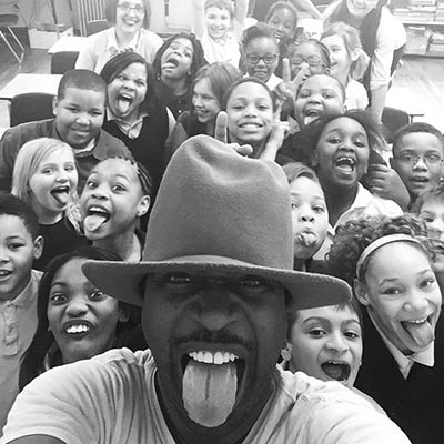 Ricky Smith with students at a school