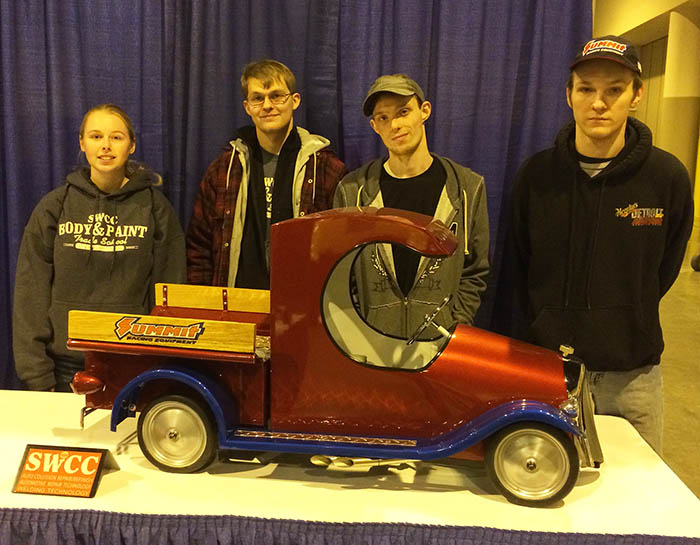 Students with pedal car