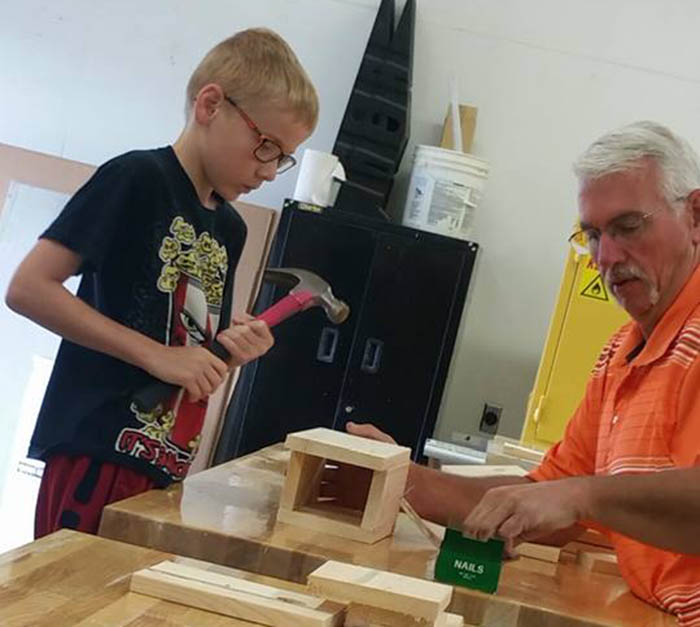Student working on birdhouse