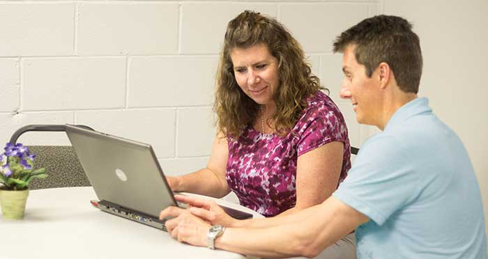 Employee helping student in distance education