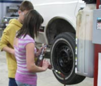 Students working on tire