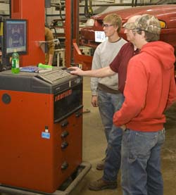 Students and instructor learning on equipment