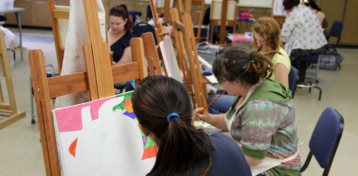 girls painting on easels