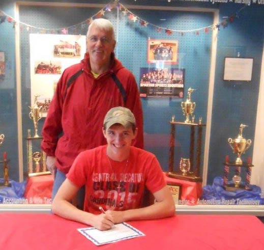 Clayton Dale signs with Spartan Sports Shooting