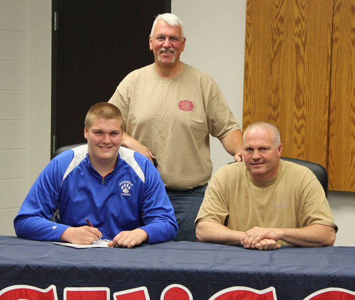 Tevor Elwood signs with Spartan sports shooting