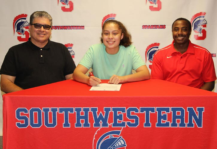 Pictured:  Rafael Aviles, Jasmine's father; Jasmine Aviles; and Southwestern Head Women's Basketball Coach Addae Houston