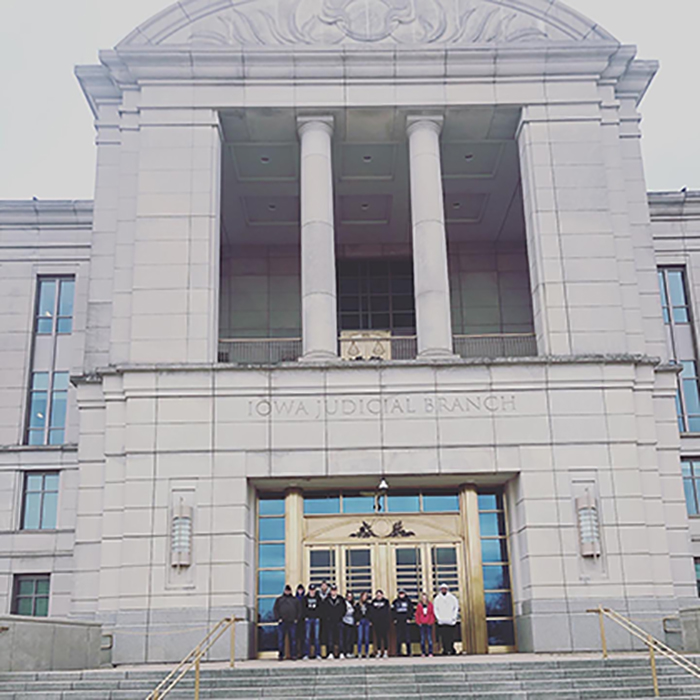 Criminal justice students pictured in front of the Iowa Judicial Branch