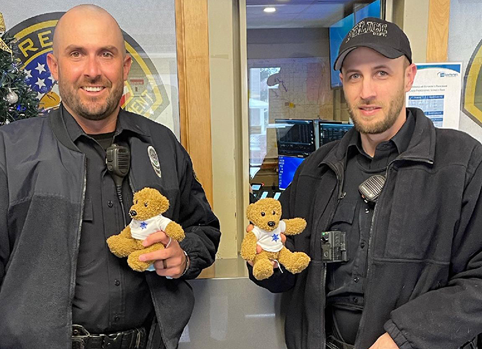 Creston Police officers holding the donated bears