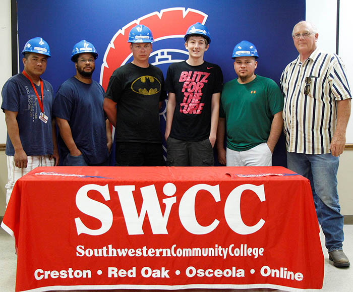 Osceola Food employees Lorens Mora, Nathaniel Rife, Michael Tyler, Jordan Roberts, and Gustavo Herrera pictured with SWCC Industrial Technology Instructor Henry Lemke.