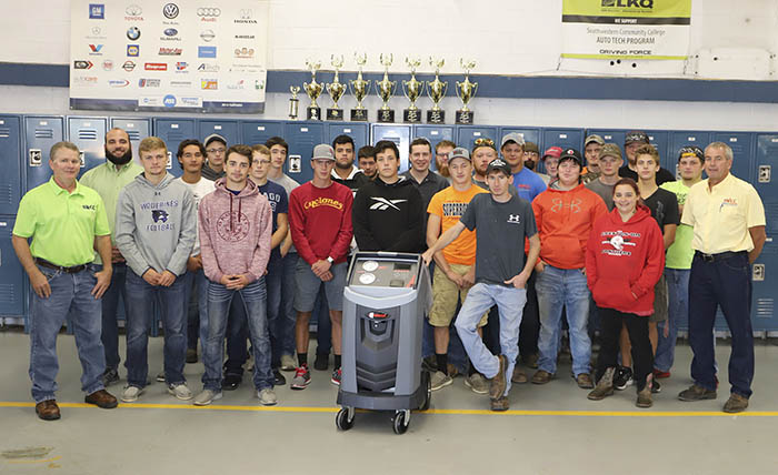 SWCC auto students and instructors pictured with new machine