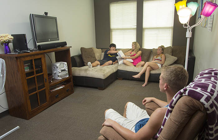 Students in Residence Hall Room Watching TV
