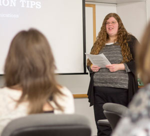 Female student presenting to class