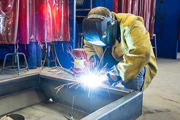 Student welding on a larg project