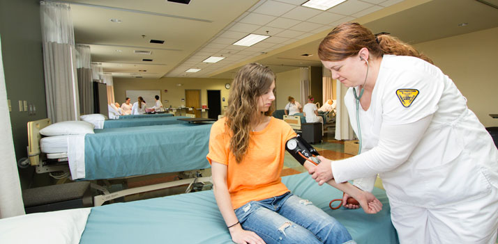 nurse with girl in orange shirt