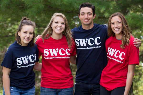 Studends wearing blue and red SWCC Logo shirts
